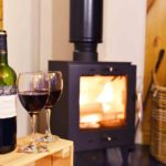 Enjoy a drink by a cosy fire